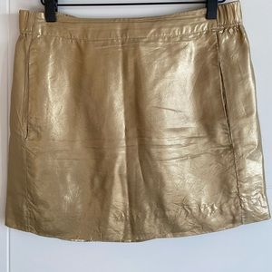 Gold silk mini skirt with pockets